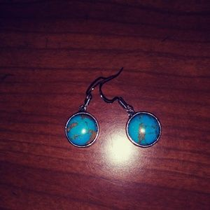 New in pkg : silver with turquoise .